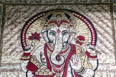 Hindu god Ganesha printed throw wall hanging on display for sale at Camden Market. Hippie India tapestry, Hindu god Ganesha printed throw wall hanging on display stock photos