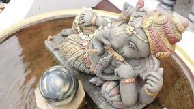 Hindu god the ganesha statue in water tub stock video footage