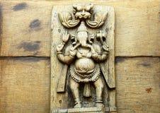 Hindu god Ganesha wooden carving Royalty Free Stock Photo