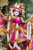 Hindu god Krishna. Bright colorful sculptural composition. Stock Photo
