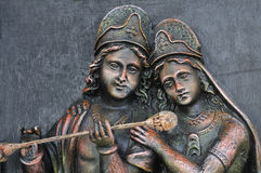Hindu God Krishna and Godess Radha. A stone carving of Hindu God Krishna and Hindu Goddesses Radha Royalty Free Stock Photos