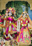 Hindu god Krishna with his wife Radha. Durban, South Africa - March 20, 2016: Hindu god Krishna with his wife Radha. Bright colorful sculptural composition Royalty Free Stock Image