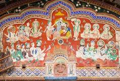 Hindu god Krishna with wife in crowd on fesco Royalty Free Stock Photo