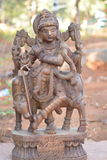 Hindu god-lord krishna. Ancient idol of lord krishna with cow carved out of stone Stock Images