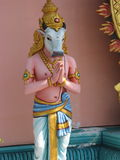 Hindu god sacred cow statue. Colurful Hindu god sacred cow statue praying Stock Image