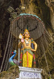 Hindu god sculpture in Batu caves, Malaysia. Bright statue of hinduist god in caves not far from Cuala Lumpur Royalty Free Stock Photos