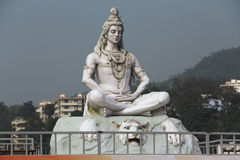 Hindu god Shiva sculpture sitting in meditation. Hindu lord Shiva sculpture sitting in meditation on Ganges river in Rishikesh, India, 2011 Stock Image