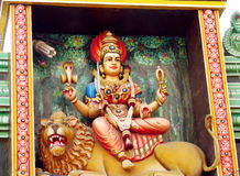 Hindu god statue and lion Stock Image