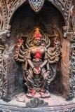 Hindu Goddess in black stone. Statue of hindu goddess Veeramakali Amman carved in black stone Royalty Free Stock Photography