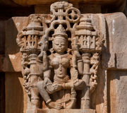 Hindu goddess Lakshmi on the ancient front of traditional indian stone temple. Rajasthan Stock Photos