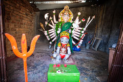 Hindu Goddess with many hands. Goddess statue with many hands in the small temple in Maharashtra, India stock photography