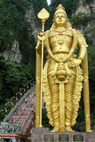 Hindu Gods can also be seen in the Cave. Main attraction is the gold large statue of the Hindu God, Batu Caves Temple in Kuala Lumpur, Malaysia stock photography