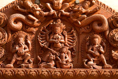 Hindu Gods carved on wood Royalty Free Stock Photo