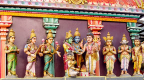 Hindu Gods colorful statues in India. Colored statue on the wall in front of the entrance to the hindu temple with ornament and decorations. Man and woman figure stock images