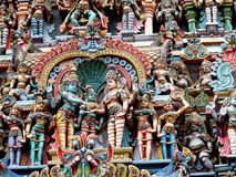 Hindu gods and godess statues. Colored statue on the wall in front of the entrance to the hindu temple with ornament and decorations. Man and woman figure royalty free stock images