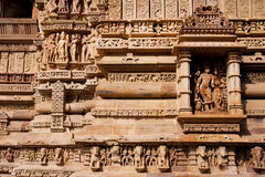 Hindu gods life on facade of Khajuraho temples Stock Photo