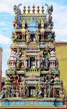 Hindu gods statues on a temple gopuram. Colored statue on the wall in front of the entrance to the hindu temple with ornament and decorations. Man and woman stock images