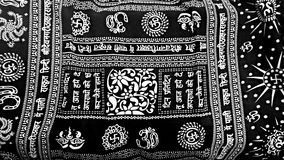 Hindu graphic screen on fabric Royalty Free Stock Photo