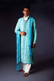 Hindu groom. Beautiful authentic Indian hindu man in typical ethnic groom attire. Bengali male wearing a light blue agua decorated Dhoti with shawl Stock Photos