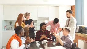 Hindu guy in checked shirt is getting congratulations from. Team while drinking tea stock footage