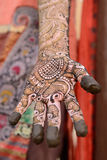 Hindu henna design on hands of women from India. Stock Images