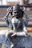 Hindu Idol of Shani (Saturn). This is a closeup portrait of a Hindu deity of Saturn known as Shani who is feared and worshiped on Saturdays Stock Photo