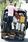 Hindu Indian Family Ride Three Wheel Taxi, Travel to India Royalty Free Stock Images