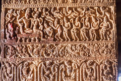 Hindu lord Shiva and his wife Parvati, servants on a column with patterns in 7th century temples in Pattadakal, India. Royalty Free Stock Image