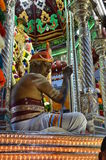 Hindu man in costume sits on vehicle for festival Stock Photography