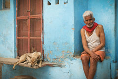 Hindu man and dog Royalty Free Stock Image