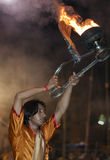 Hindu Man at Ganga Aarti Ceremony. India, Varanasi, Young Hindu Perfoming Ganga Aarti Ceremony at the Ghats of the River Ganges Stock Images