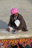 Hindu man offers prayers at the holy lakeside, Pushkar Sarovara, India Royalty Free Stock Photography