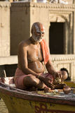 Hindu man in religious contemplation - India. A Hindu man in religious contemplation at the Hindu Ghats on the banks of the River Ganges in Varanasi in India stock images