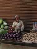Hindu man sells vegetables Stock Photography