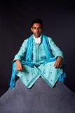 Hindu man sitting in lotus position Royalty Free Stock Images