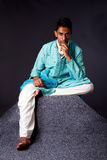Hindu man sitting and thinking Stock Photo