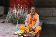 Hindu Mantra. A middle aged Hindu man doing mantra at Kamakhya temple premises in Assam-India stock photography
