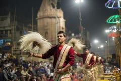 Hindu men at the religious Ganga Aarti ritual, fire puja in Varanasi, India. VARANASI, INDIA - JANUARY 25, 2017 : Unidentified Hindu priest at the religious Stock Photography