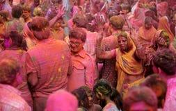 Hindu men and women celebrating Holi festival Royalty Free Stock Photos