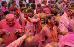 Hindu men and women celebrating Holi festival Royalty Free Stock Photography