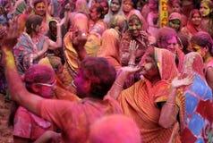 Hindu men and women celebrating Holi festival Stock Photography