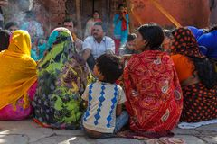 Hindu men and women in colorful sari at Durbar Square in Nepal Royalty Free Stock Photography