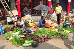 Hindu men and women in Indian street market Stock Images