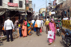 Hindu men and women in Indian street market Stock Image