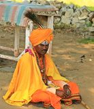 Hindu monk in traditional orange dress, village of India Royalty Free Stock Images