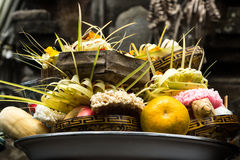 Hindu offering in Bali. Hindu offering dish with flowers, fruits and natural braids.  Bali. Indonesia Stock Image