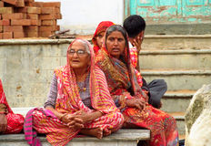 Hindu old women dressed in colorful sari in Indian street Stock Photos