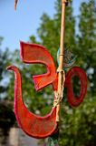 Hindu Om and Muslim crescent star symbols together outside temple Sindh Pakistan Stock Photos
