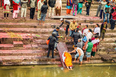 Hindu people attend a religious burial ceremony in Nepal Stock Photography