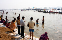 Hindu people bathe in holy Sangam Royalty Free Stock Photo